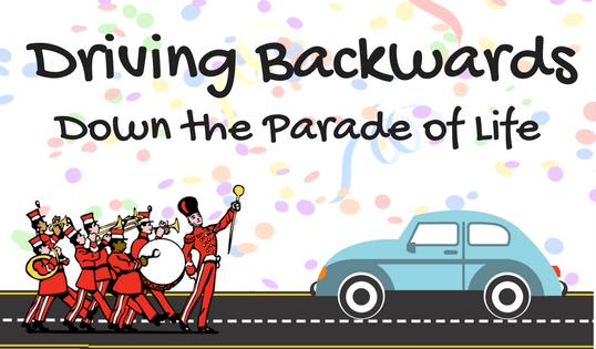 Driving Backwards Down the Parade of Life